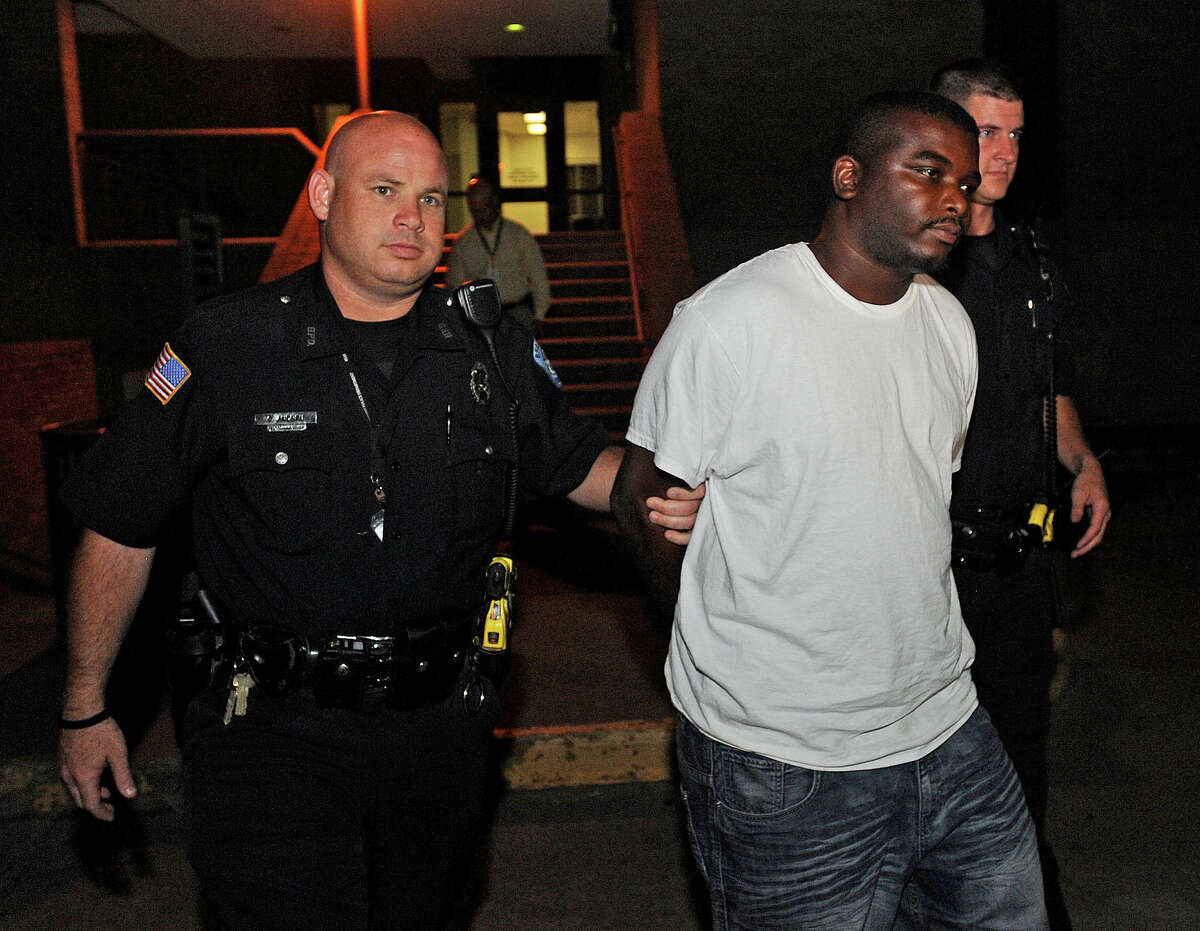 Beaumont police escort Terry Frazier, 28, from the police department Tuesday night as a suspect in the 2012 murder of Aaron Leffage, 20, at a home on the 3200 block of Wilshire. Frazier is being charged with capitol murder. Photo taken Wednesday, June 02, 2013 Guiseppe Barranco/The Enterprise