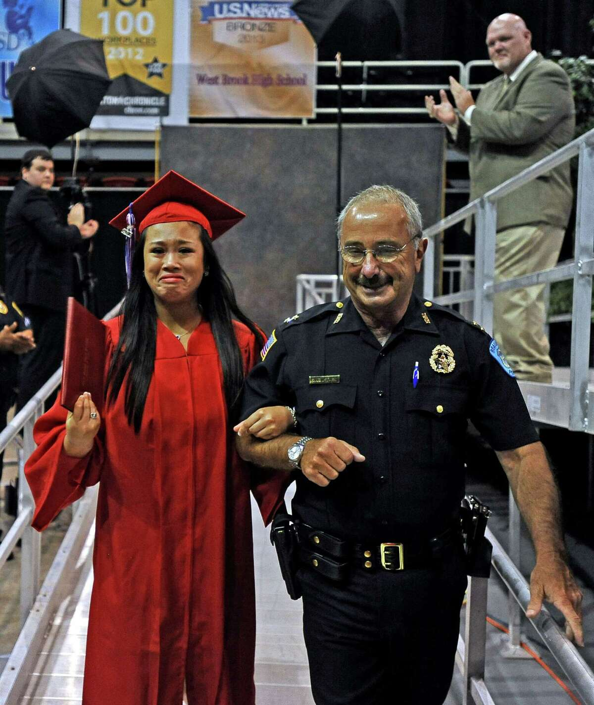 Beaumont ISD West Brook High School Graduation: 10 a.m. June 7 at the Montagne Center (File photo) Celina Grace Fabie Gernale, daughter of Beaumont police officer Conrad Gernale who was killed on duty in 2002, graduated in the West Brook High School class of 2013 on Saturday, June 8, 2013. After receiving her diploma she was escorted by Beaumont Police Chief Jim Singletary off the stage and greeted by numerous other Beaumont police officers. Photo taken: Randy Edwards/The Enterprise