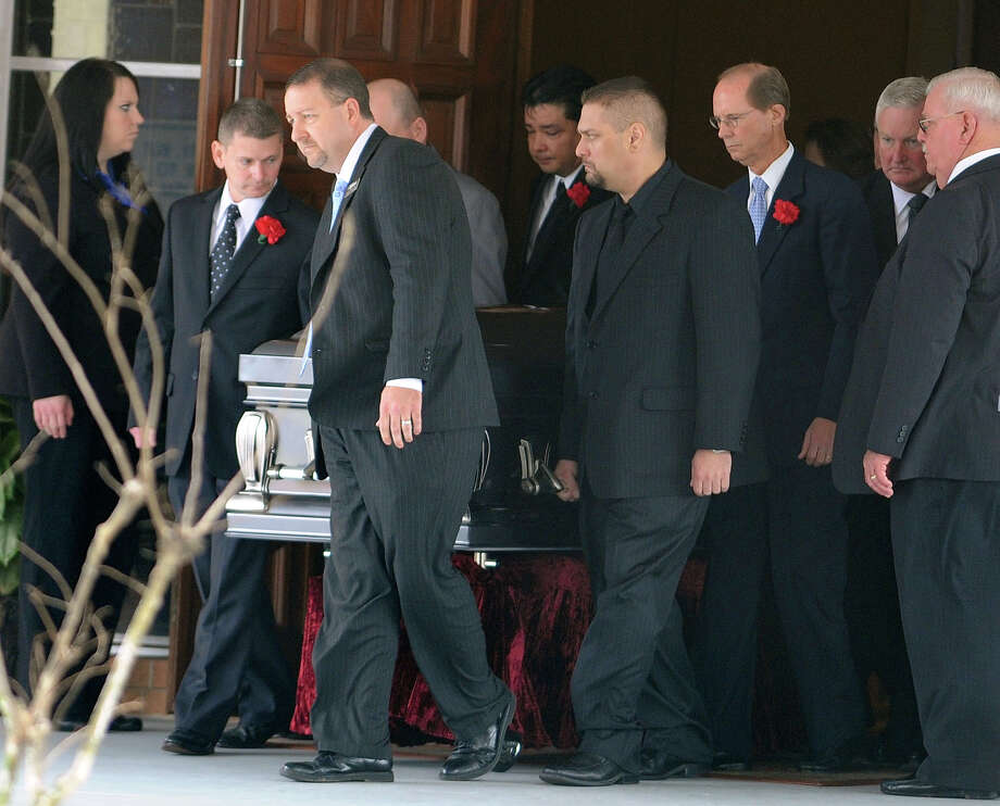 Pallbearers escort Victor Lovelady's casket from services at St. Charles Catholic Church in Nederland on Tuesday January 29. Lovelady was killed after a terrorist attack at an Algerian gas plant where he worked.  Photo taken Tuesday, January 29, 2013 Guiseppe Barranco/The Enterprise Photo: Guiseppe Barranco, STAFF PHOTOGRAPHER / The Beaumont Enterprise