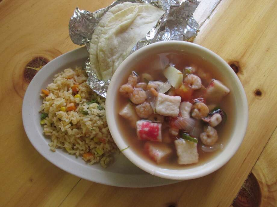 Sopa de marisco (seafood soup) with a side of rice and  corn tortillas at El Paraiso on College STreet. Photo: Cat5