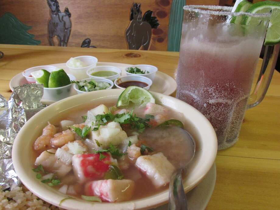 Seafood soup (marisco), selections from the salsa bar and michelada beer at El Paraiso on College Street. Photo: Cat5