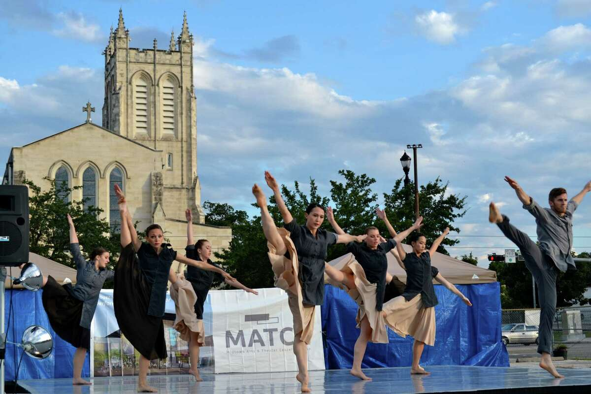 Dancers perform on the site for the planned Midtown Arts and Theater Center Houston.