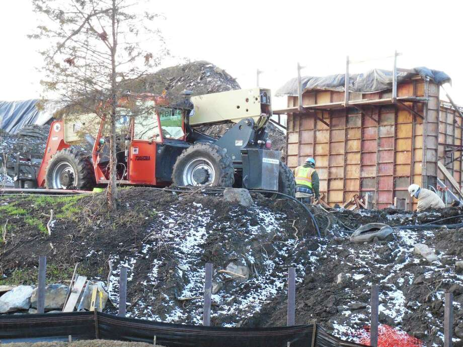Construction workers at the site of the new Levitt Pavilion for the Performing Arts. Photo: Anne M. Amato / Westport News