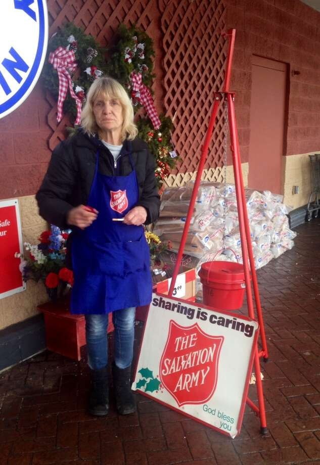 Despite frigid weather and busy shoppers, bell ringers for the Salvation Army seek donations to help the less fortunate. Photo: Courtney Suitto