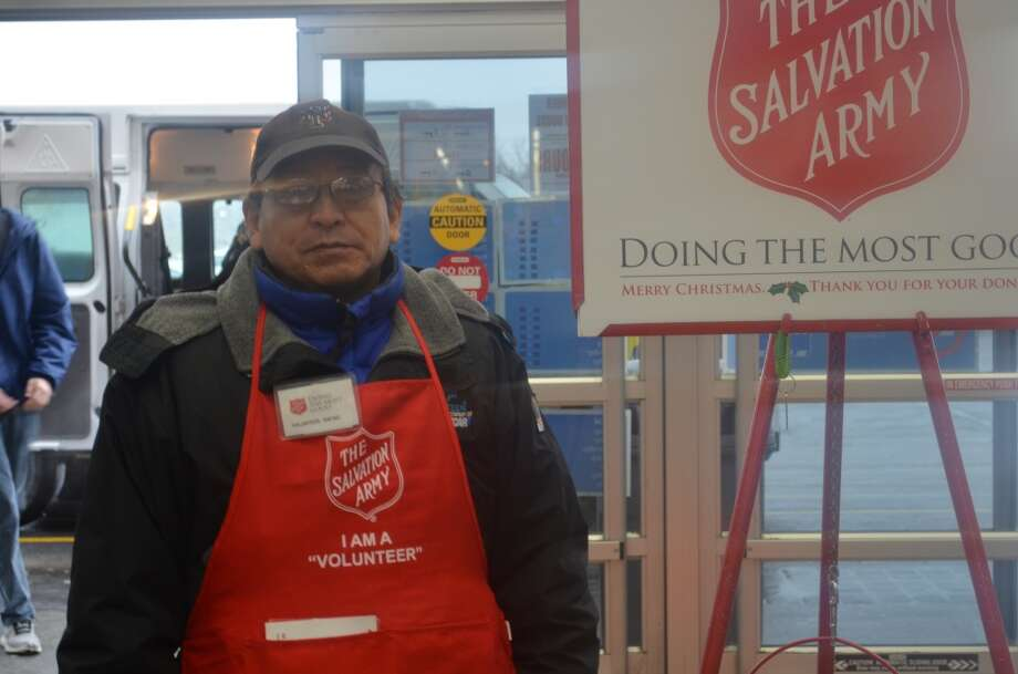 Salvation Army volunteer ringing a bell for Walmart goers. Photo: Audrey Goodemote