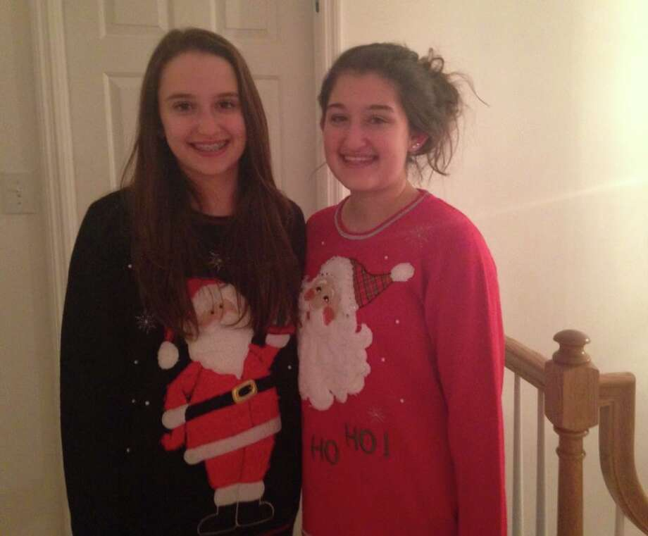 Julie Hollister (left) and Sarah Hollister (right) attended an ugly Christmas sweater party. Photo: Rachel Bahor