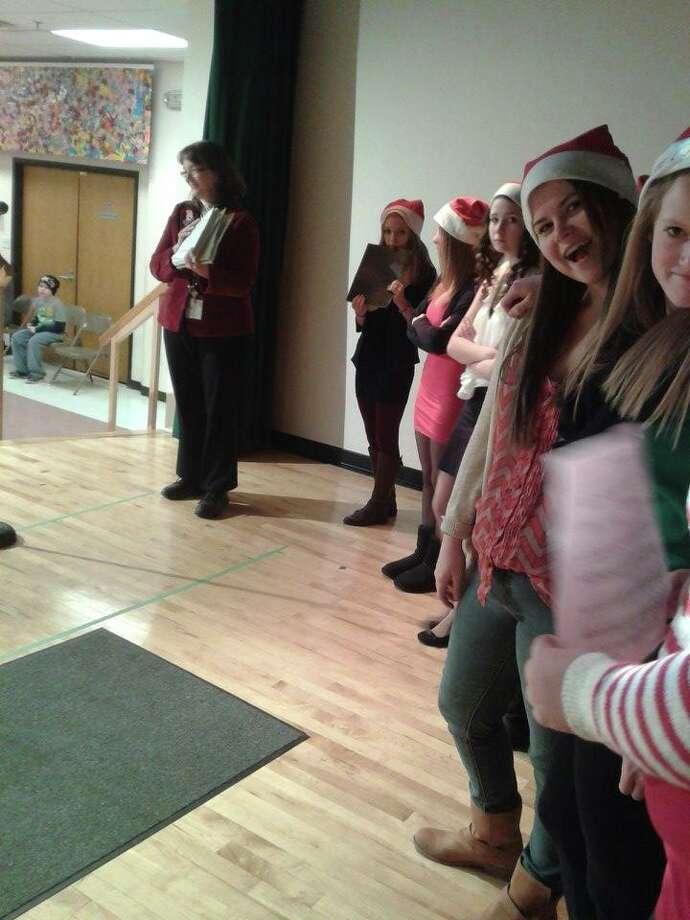 The singers line up and prepare to spread holiday cheer! Photo: Chloe Snyder