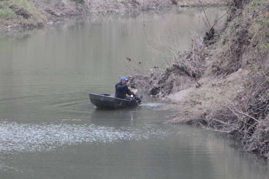 Texas EquuSearch checks Cypress Creek in a boat equipped with sonar for signs of Melissa Sowders, who has been missing since Dec. 26.