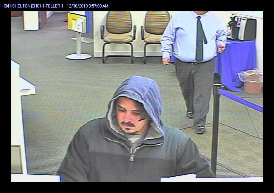Suspect in holdup Monday of the Webster Bank in Shelton, from the bank's security camera. Photo: Contributed Photo / Connecticut Post Contributed