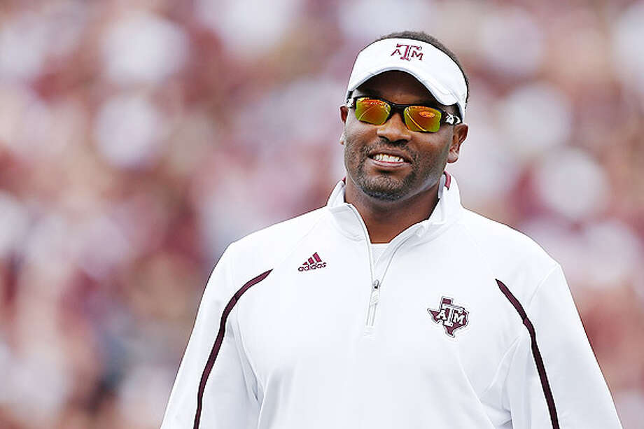 Kevin Sumlin enjoys one final go-round with John Football before discovering life without  Manziel. Photo: Scott Halleran, 2013 Getty Images / 2013 Getty Images