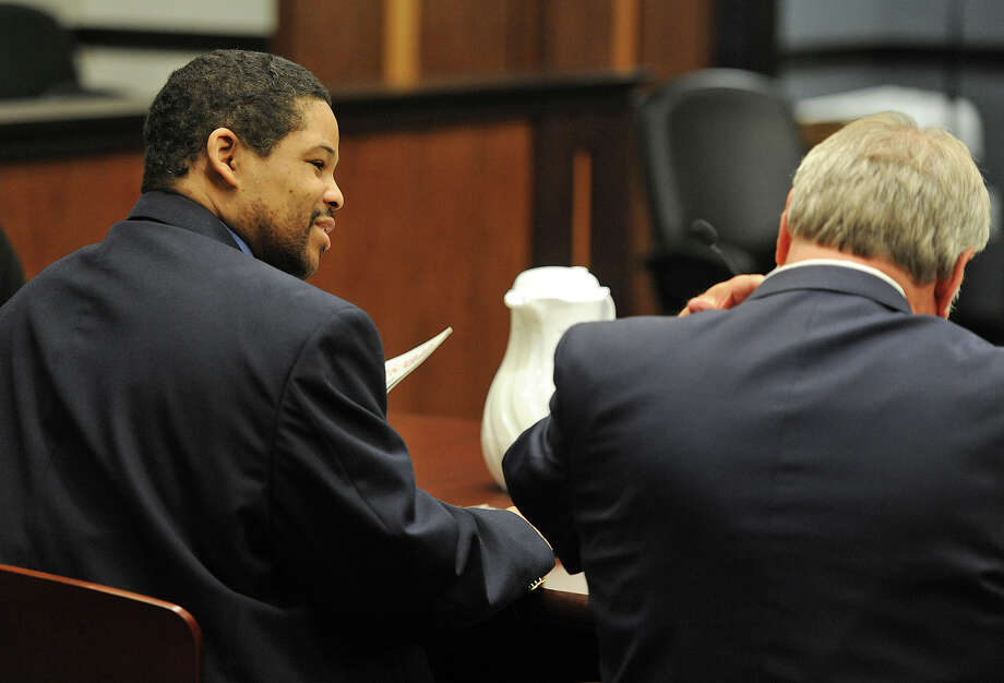 Bartholomew Granger, left, and his attorney James Makin just before the second day of trial begins in a Galveston County courtroom on Tuesday. Granger stands trial for the 2012 shooting of Minnie Ray Sebolt at the Jefferson County Courthouse. Photo taken Tuesday, April 23, 2013 Guiseppe Barranco/The Enterprise Photo: Guiseppe Barranco, STAFF PHOTOGRAPHER / The Beaumont Enterprise