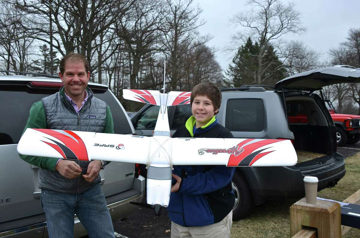 New club member Chad Hildner beams as he shows off his Christmas present with his dad, Ted Hildner, during this week's Sunday morning gathering of the New Canaan Radio Control Society at Waveny Park. Dec. 29, 2013, New Canaan, Conn.