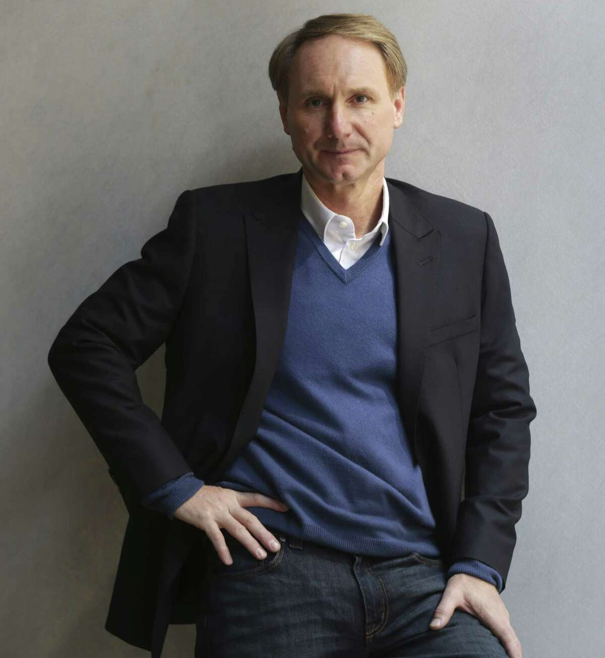 """FILE - In this May 13, 2013 file photo, author Dan Brown poses for a portrait in New York. His new book, """"Inferno,"""" published by Doubleday released on May 14. No mega-sellers came out in 2013, nothing that compared with E L James' """"Fifty Shades of Gray"""" or Stieg Larsson's crime novels. Adult readers turned to dependable favorites such as Dan Brown and Khaled Hosseini, while teens and grade-schoolers stuck with Rick Riordan, Jeff Kinney and Veronica Roth, whose """"Divergent"""" series is set to debut on the big screen in 2014. (AP Photo/Seth Wenig, File) ORG XMIT: NYET341"""