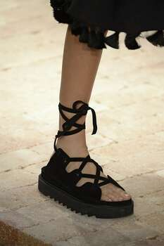 """July 29: We notice that Birkenstocks are slowly making a comeback in San Francisco, and then these """"ugly shoes"""" are officially anointed as the hot sandal of the summer by Vogue. We're still wondering how these sensible sandals, with their orthopedic-looking heels and thick straps, made their way back into our closets ... Photo: Catwalking, Getty Images"""