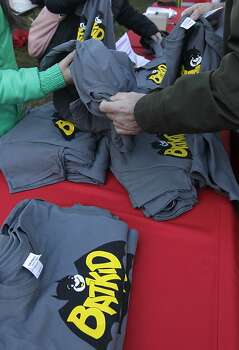 """Nov. 15: When the Make-a-Wish Batkid comes to town, San Franciscans take to the streets to cheer on the young cancer survivor's day of make-believe in """"Gotham City."""" The hottest accessory in the city becomes the Batkid T-shirt. whether DIY or one of the official SFPD giveaways. Photo: Paul Chinn, The Chronicle"""