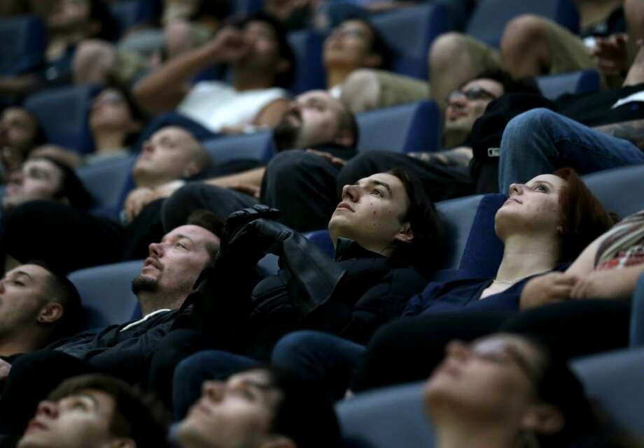 """The movie theater. It's cold, dark, usually empty, and there's food."" -- Rick (AP Photo/Julio Cortez, file) Photo: Julio Cortez, Associated Press"