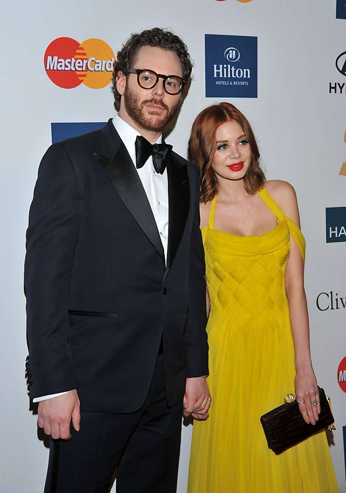 In this Feb. 11, 2012 file photo, Sean Parker, left, and Alexandra Lenas arrive at the Pre-GRAMMY Gala & Salute to Industry Icons with Clive Davis honoring Richard Branson in Beverly Hills, Calif. Facebook billionaire Sean Parker's lavish, $10-million Big Sur wedding just got even more expensive. The California Coastal Commission and Parker on Monday said they reached a $2.5 million settlement to pay for coastal conservation programs after the Napster co-founder built a large movie-set like wedding in an ecologically sensitive area of Big Sur without proper permits. (AP Photo/Vince Bucci, file)