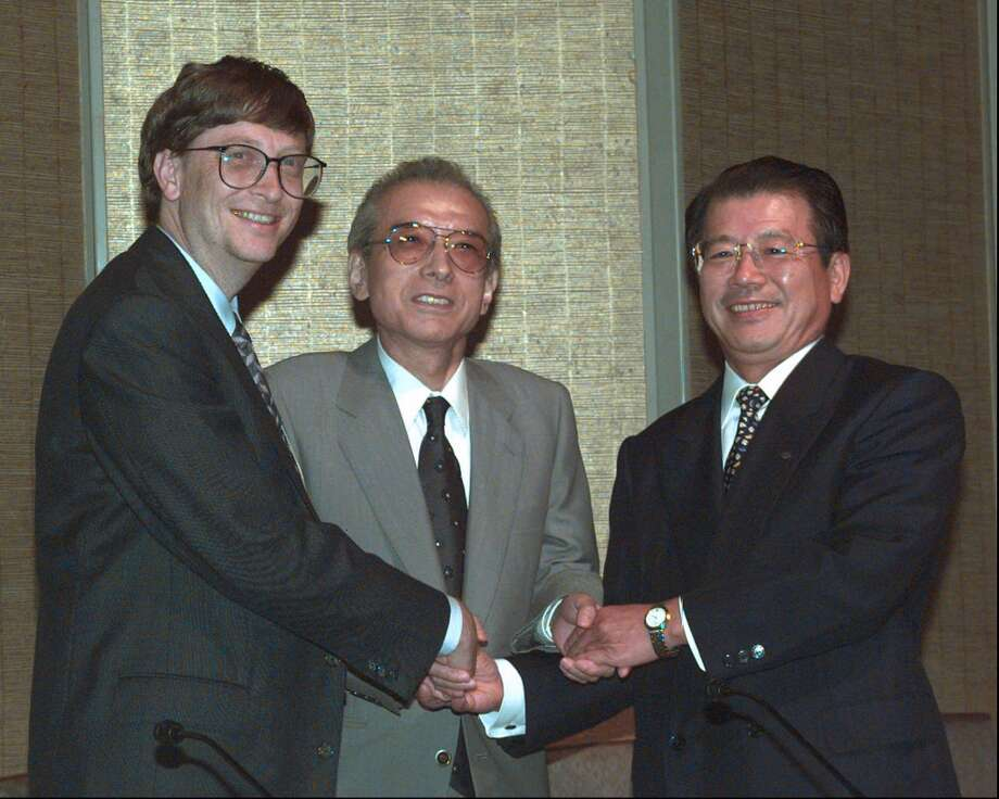 Hiroshi Yamauchi (center)saved Major League Baseball by buying a majority stake in the Seattle Mariners, but confessed that he wasn't much interested in the game and never set foot inside Safeco Field.  Under his tutelage, the M's signed Ichiro Suzuki and opened the way for Japanese players in the majors.  Yamauchi, who died at 85, took over his family's playing card company in 1949 and built it into a video game empire. Seattle was lucky that Nintendo USA had its headquarters here, or the Mariners might be playing in Florida. Photo: KATSUMI KASAHARA, Associated Press
