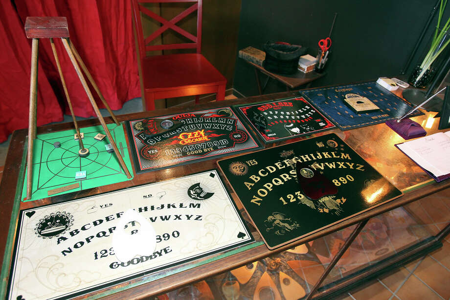Gordon Wiseman's Ouija board museum, which opened in October, displays examples from different eras and manufacturers. Photo: Tom Reel, San Antonio Express-News / San Antonio Express-News