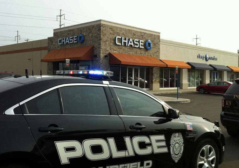 Police on scene at the Chase Bank office in Kings Crossing shopping center on Grasmere Avenue, which was robbed Thursday, Sept. 12, 2013, a short time after a Bank of America branch on Kings Highway Cutoff. Photo: Genevieve Reilly / Fairfield Citizen