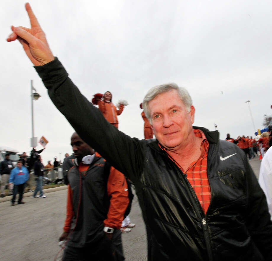 "Texas Longhorns head coach Mack Brown flashes the ""Hook 'em Horns"" as he arrives before the Valero Alamo Bowl with the Oregon Ducks Monday Dec. 30, 2013 at the Alamodome. Photo: Edward A. Ornelas, San Antonio Express-News / © 2013 San Antonio Express-News"