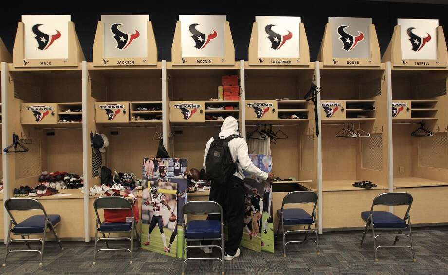Texans cornerback Brice McCain stops by his locker as he and the other Texans players clean out their lockers after their 2-14 season. Photo: Karen Warren, Houston Chronicle