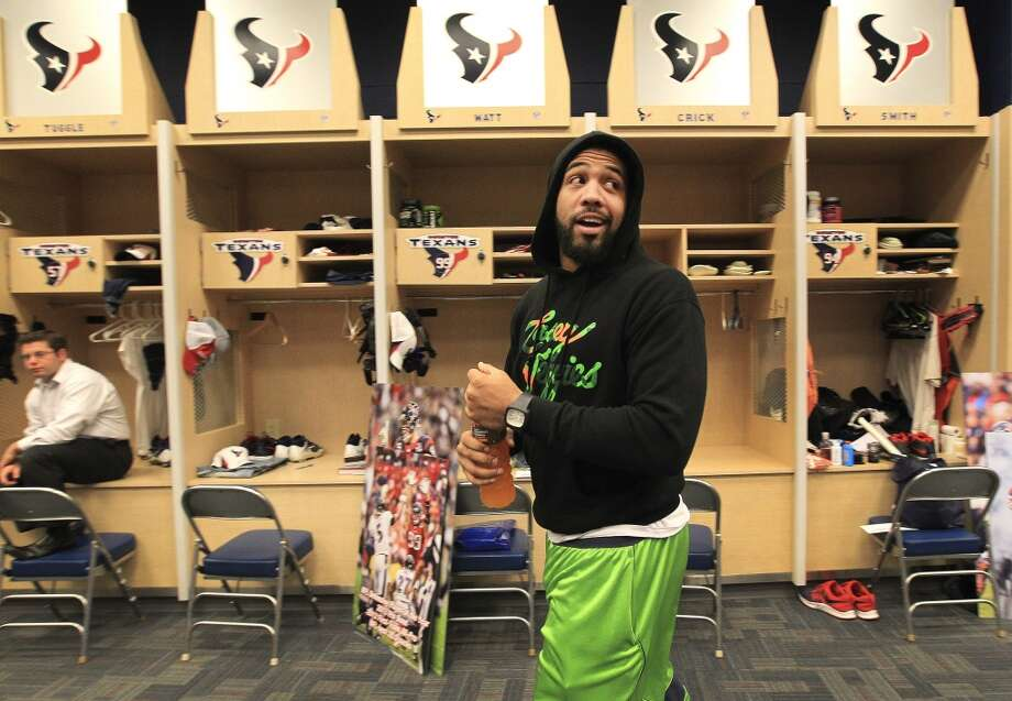 Texans running back Arian Foster walks through the locker room as he and the other Texans players clean out their lockers after their 2-14 season. Photo: Karen Warren, Houston Chronicle