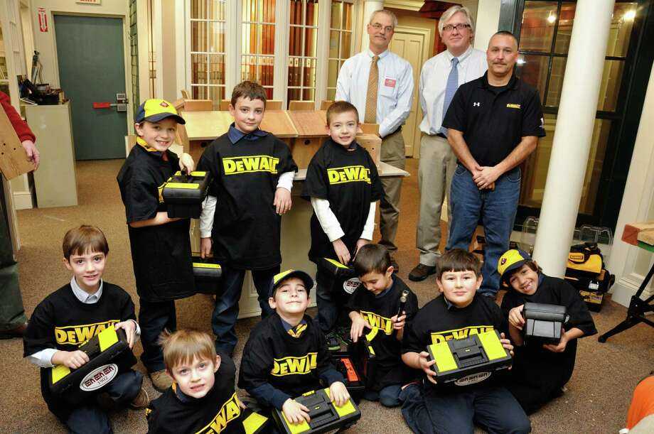 Cub Scout Pack 570 Den 2 from St. Rose in Newtown visited Rings End in Bethel on Dec. 18. The staff there helped the boys build bird houses.  On hand was a representative of Dewalt, who helped the boys use power tools.  Rings End gave each scout a tool box to keep.  The boys are, left to right, kneeling: Mason Harper, Toby Johnson, Joshua Schumacher, Francis Kahn, Jonathan Stuart and Nicolaus Llopis. Scouts Vincent Bordash, Rohan Carey and Evan Johnson stand behind them. At right in rear are David Rhor, Rings End general manager; Mark Smith; and Todd Gilbert, from Dewalt. Photo: Contributed Photo / The News-Times Contributed