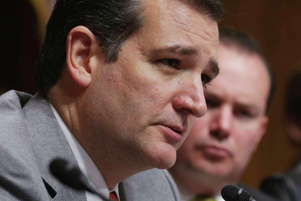 WASHINGTON, DC - NOVEMBER 20: Senate Judiciary Committee members U.S. Sen. Ted Cruz (R-TX) (L) and U.S. Sen. Mike Lee (R-UT) (R) question David Barron during his nomination hearing in the Dirksen Senate Office Building November 20, 2013 in Washington, DC.