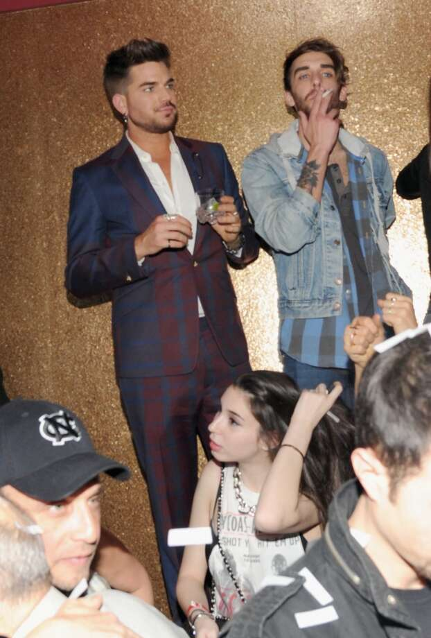 Adam Lambert attends Miley Cyrus' unveiling of Beacher's Madhouse Las Vegas at the MGM Grand Hotel & Casino on December 27, 2013 in Las Vegas, Nevada. Photo: Kevin Mazur, WireImage