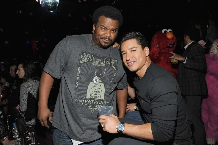 Craig Robinson and Mario Lopez attend Miley Cyrus' unveiling of Beacher's Madhouse Las Vegas at the MGM Grand Hotel & Casino on December 27, 2013 in Las Vegas, Nevada. Photo: Kevin Mazur, WireImage
