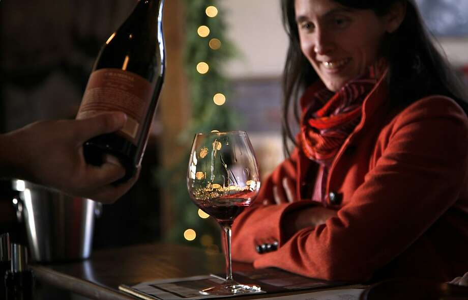 Rachel Gallery samples at Chamisal Vineyards in San Luis Obispo, which offers both a basic ($15) and formal ($50) wine tasting. Among the offerings are Pinot Noir, Chardonnay, Grenache, Syrah and Rose. Photo: Preston Gannaway, Special To The Chronicle