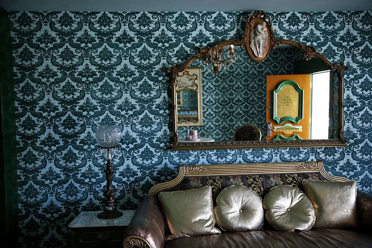 The Madonna Inn in San Luis Obispo, which opened in 1958, has antique furniture in its 110 themed rooms like the Irish Hills room, left, and the Romance room, above, as well as an outdoor heated pool and spa, top. There is also a waterfall urinal in the men's room.