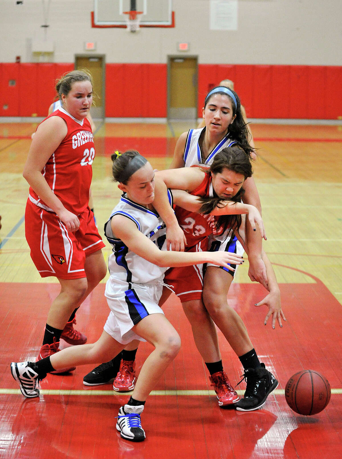 Darien's Avery Maley, left, and Julia Cornacchia battle Greenwich's Jamie Kockenmeister for the ball during the championship final of the 19th annual Tony LaVista Basketball Tournament at New Canaan High School in New Canaan, Conn., on Monday, Dec. 30, 2013. Greenwich won 66-36.