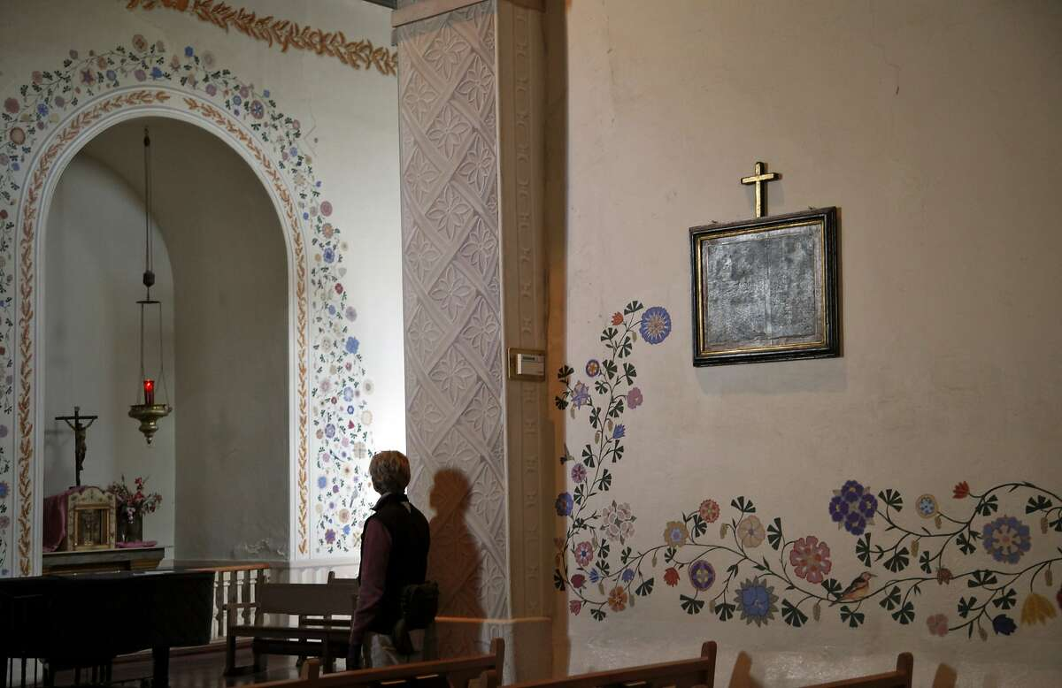 A woman admires the chapel in Mission San Luis Obispo de Tolosa in San Luis Obispo, Calif., on Friday, December 20, 2013.