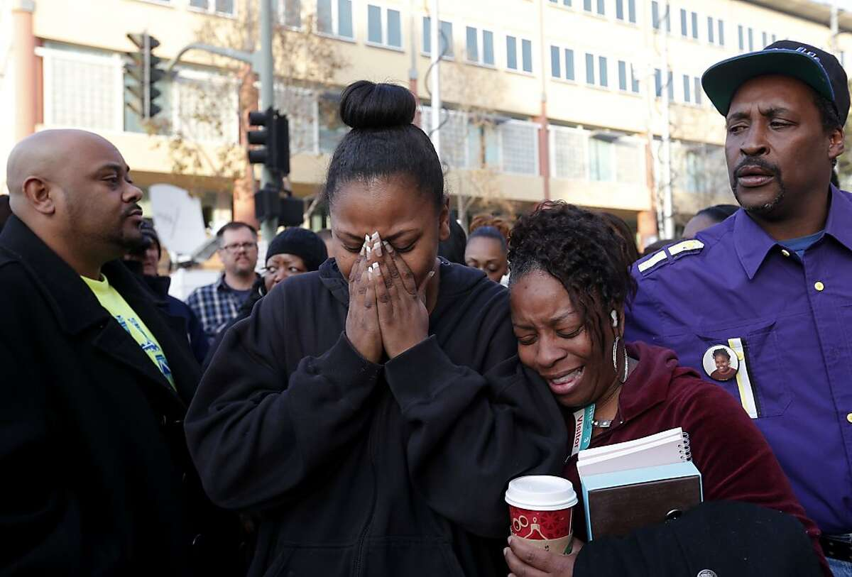 The mother of Jahi McMath, Nailah Winkfield, (left) and Dr. DeTrice Rodgers, Jahi's 5th grade teacher, embrace after they stated that the court order to remove Jahi from a ventilator has been extended to January 7th 2014. The statement was made by the family to the news media in front of Children's Hospital in Oakland, Ca. , on Monday Dec. 30, 2013.