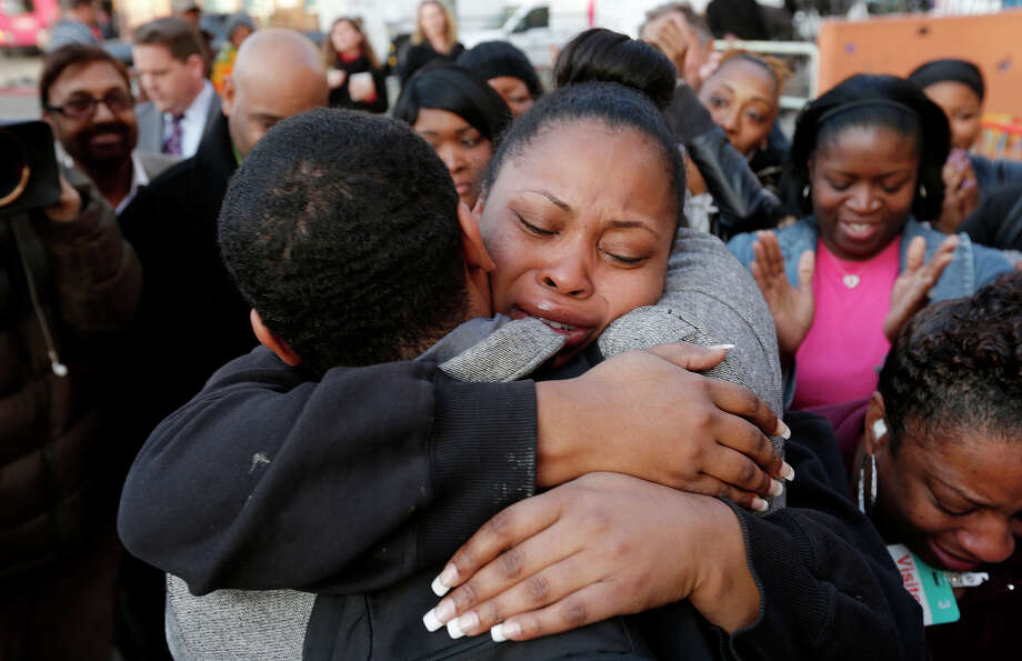 Nailah Winkfield, the mother of brain-dead girl Jahi McMath, embraces her brother Omari Sealey, after they stated that the court order to remove Jahi from a ventilator has been extended to January 7th 2014. The statement was made by the family to the news media in front of Children's Hospital in Oakland, Ca. , on Monday Dec. 30, 2013. 13-year-old Jahi McMath is slated to be removed from a ventilator at 5pm this afternoon, after being declared brain-dead by the hospital. Photo: Michael Macor / The Chronicle / ONLINE_YES