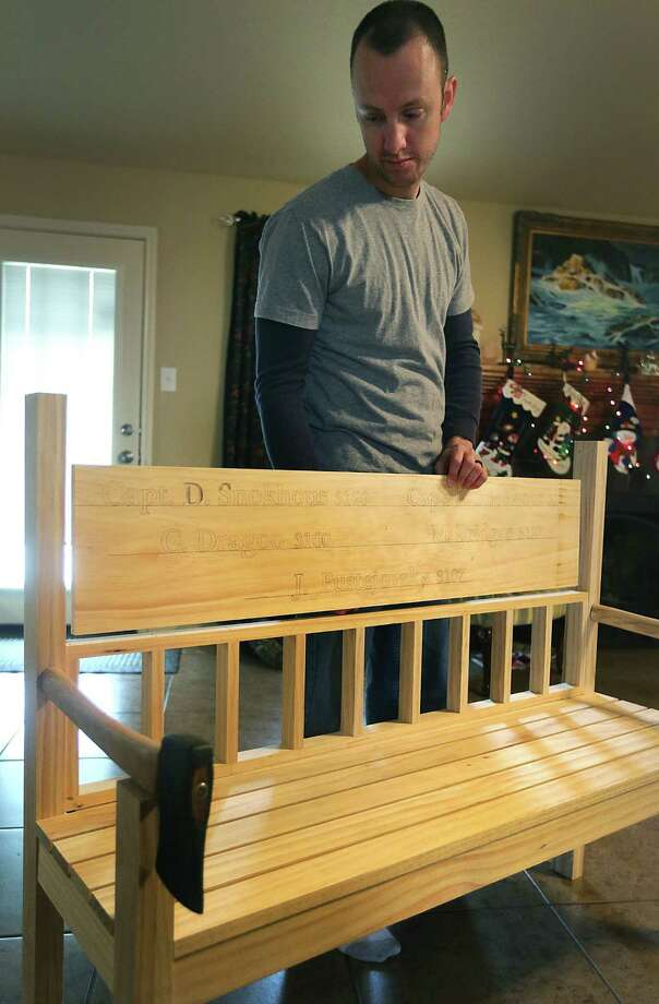 Officer Tommy Capell who makes honor chairs for first responders killed in action holds a bench he is making for the firefighters killed in the West explosion. Photo: San Antonio Express-News / © 2012 San Antonio Express-News