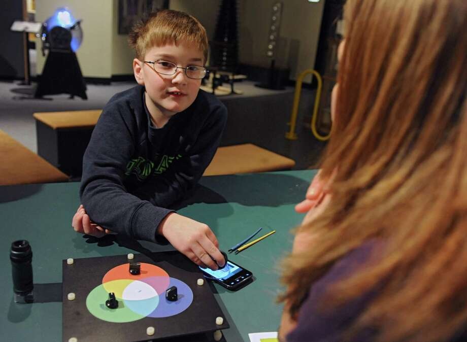 Nathan Lala, 8, of Clifton Park listens to education specialist Beth Hoffman as he learns about how an LCD display uses pixels and color as children learn how technology works at The Pocket Tech suite of demonstration program at MiSci on Monday, Dec. 30, 2013 in Schenectady, N.Y. (Lori Van Buren / Times Union) Photo: Lori Van Buren / 00025193A