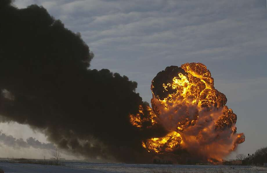A fireball goes up at the site of an oil train derailment near Casselton, N.D., about 25 miles west of Fargo. Residents were evacuated from their homes, but no injuries were reported. Photo: Bruce Crummy, Associated Press