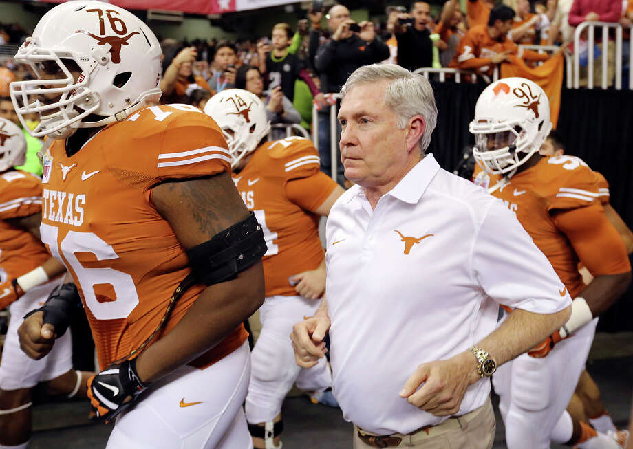 Texas Longhorns head coach Mack Brown takes the field with the team before the Valero Alamo Bowl against the Oregon Ducks Monday Dec. 30, 2013 at the Alamodome. Photo: Edward A. Ornelas, San Antonio Express-News / © 2013 San Antonio Express-News