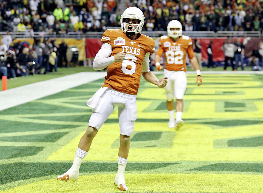 Texas Longhorns' Case McCoy celebrates after scoring a touchdown against the Oregon Ducks during first half action of the Valero Alamo Bowl Monday Dec. 30, 2013 at the Alamodome. Photo: Edward A. Ornelas, San Antonio Express-News / © 2013 San Antonio Express-News