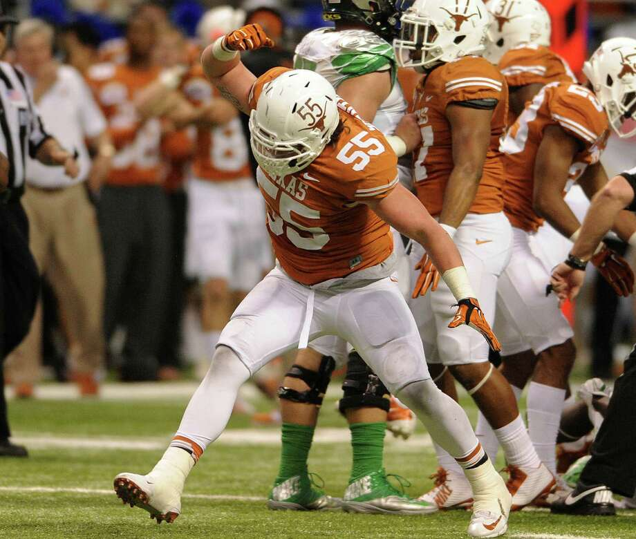 Dalton Santos of the Texas Longhorns reacts after stopping an Oregon runner during first-half action of the Valero Alamo Bowl in the Alamdome on Monday, Dec. 30, 2013. Photo: Billy Calzada, San Antonio Express-News / San Antonio Express-News
