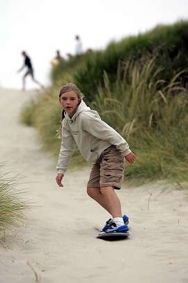 Marissa Beale, 9, navigates a gentle grade. Home to the Oregon Dunes National Recreation Area, the state's central coast is a paradise for sand sports, with an estimated 2 million people each year lugging sandboards and transporting ATVs, motorcycles, quads and dune buggies to the region. Illustrates TRAVEL-SANDBOARD (category t) by Hugo Martin (c) 2007, Los Angeles Times. Moved Tuesday, Sept. 18, 2007. (MUST CREDIT: Los Angeles Times photo by Spencer Weiner.)