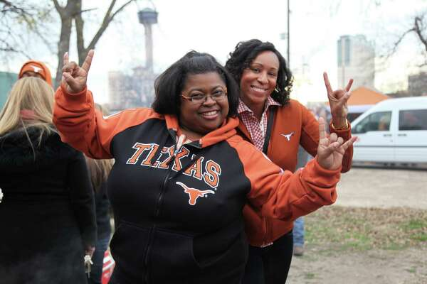 Fans turn out to tailgate before the Texas Longhorns take on the Oregon Ducks at the 2013 Alamo Bowl on Dec. 30, 2013.