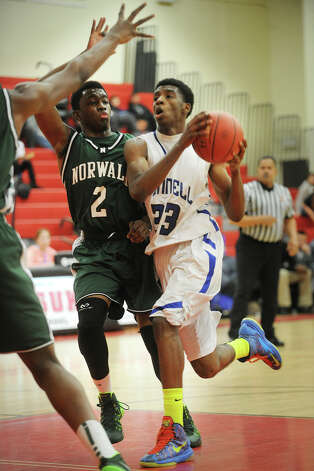 Bunnell's Isaac Vann drives the lane against Norwalk defender Zaire Wilson in the finals of the Masuk Holiday Boys Basketball Tournament at Masuk High School in Monroe, Conn. on Monday, December 30, 2013. Photo: Brian A. Pounds / Connecticut Post