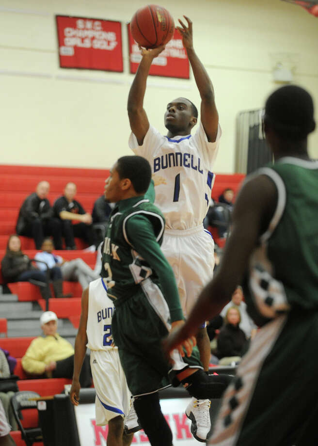 Bunnell's Ryan Pittman rises for a jump shot during a matchup with Norwalk in the finals of the Masuk Holiday Boys Basketball Tournament at Masuk High School in Monroe, Conn. on Monday, December 30, 2013. Photo: Brian A. Pounds / Connecticut Post