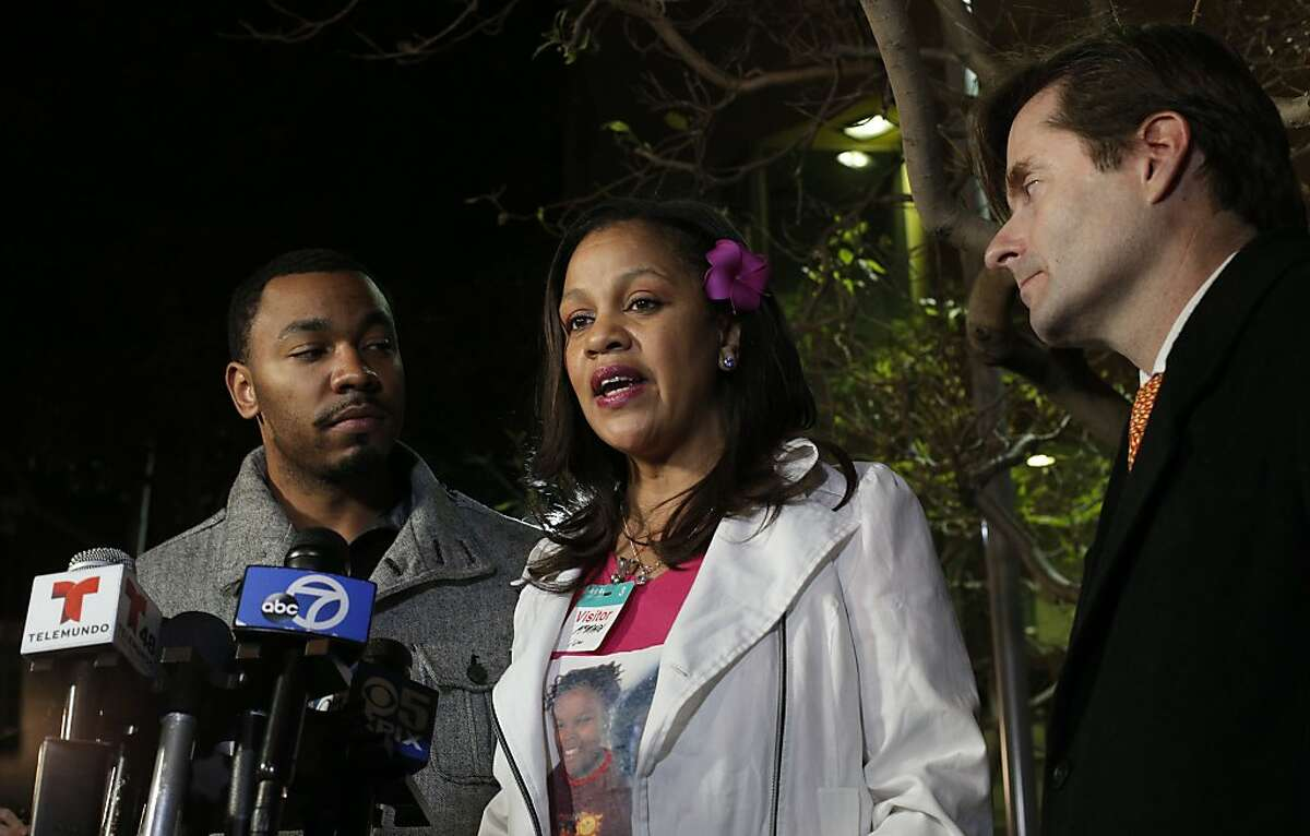 Jahi's Uncle Omari Sealey, (left) listens as Sandra Chatman talks about her grandaughter Jahi McMath while being joined by the family attorney Christopher Dolan, as they speak to the news media about the court ordered extension in front of Children's Hospital in Oakland, Ca., on Monday Dec. 30, 2013. 13-year-old Jahi McMath was slated to be removed from a ventilator at 5pm this afternoon but a court order has extended the deadline for the removal of the ventilator until 5pm January 7, 2014.