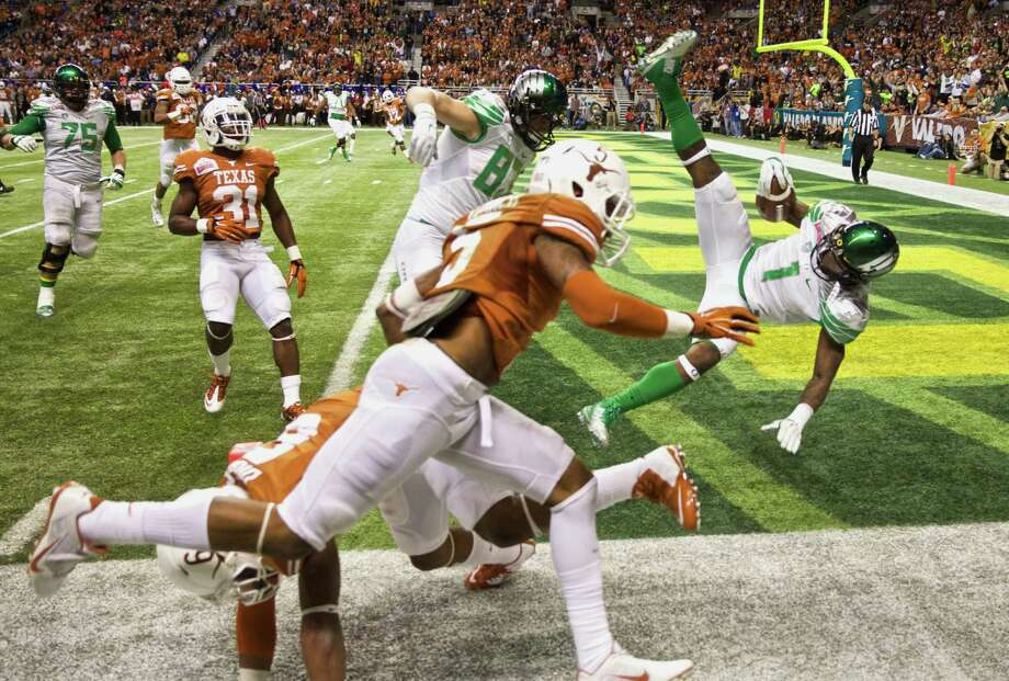 Oregon Ducks wide receiver Josh Huff (1) flies into the end zone in last seconds of the second quarter to make the score 20-7 against the Texas Longhorns in the Valero Alamo Bowl NCAA college football game in San Antonio, Texas, at the Alamodome, Mon, Dec 30, 2013. Photo: Thomas Booyd, Associated Press / The Oregonian