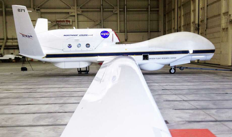 FILE - This Sept.  2013 file photo shows The Reaper drone, now known as a Global Hawk, at Edwards Air Force Base in California. The Federal Aviation Administration announced six states on Monday Dec. 30, 2013, that will develop test sites for drones, a critical next step for the march of the unmanned aircraft into U.S. skies. Alaska, Nevada, New York, North Dakota, Texas and Virginia will host the research sites, the agency said. (AP Photo/ Las Vegas Sun, Richard Velotta, File) LAS VEGAS REVIEW JOURNAL OUT ORG XMIT: NVLVS201 Photo: Richard Velotta / Las Vegas Sun